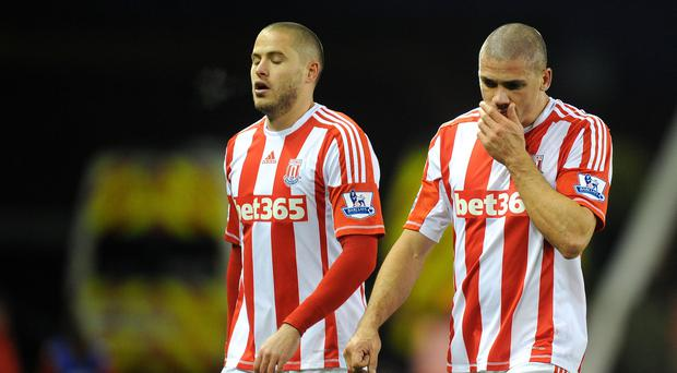 Stoke City's Jonathan Walters (right) leaves the pitch at the final whistle after scoring two own goals and missing a penalty during a Barclays Premier League match at the Britannia Stadium, Stoke (Martin Rickett/PA)