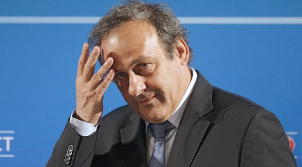 Michel Platini has been detained for questioning by French police over the awarding of the 2022 World Cup to Qatar (Lionel Cironneau/AP).