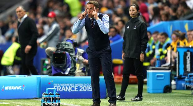 Phil Neville is not ready to take things easy against Japan (John Walton/PA)