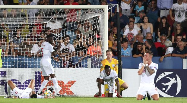 England players are dejected after Aaron Wan-Bissaka's late own goal. (Nick Potts/PA)