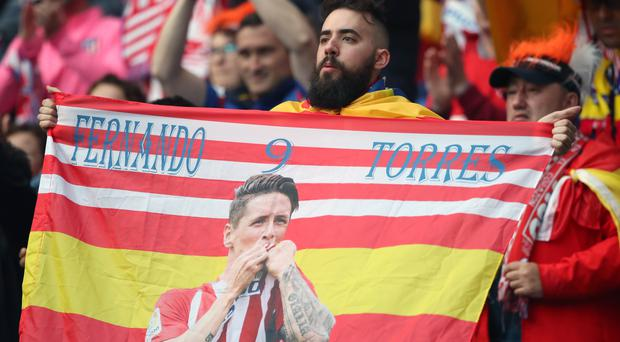 An Atletico Madrid fan holds up a flag of Fernando Torres during the 2018 Europa League final (Nick Potts/PA)