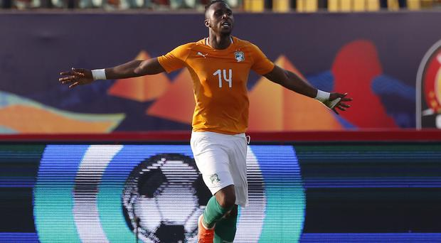 Ivory Coast's Jonathan Kodjia celebrates his goal against South Africa (Amr Nabil/AP).
