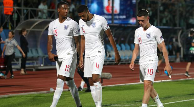 Ezri Konsa (left), Jake Clarke-Salter (centre) and Phil Foden are left dejected after England Under-21s' 3-3 draw with Croatia. (Nick Potts/PA)