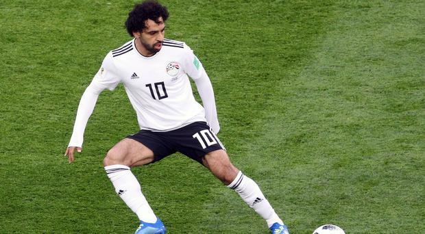 Mohamed Salah's Egypt have already secured a place in the last 16 of the African Nations Cup. (Owen Humphreys/PA)