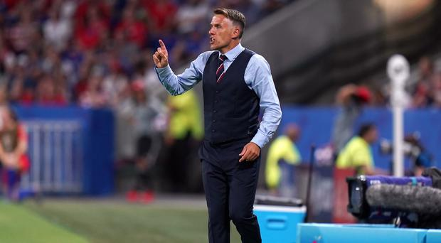Phil Neville is aiming for success in the near future with England (John Walton/PA)