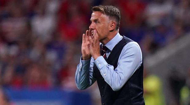 Phil Neville is committed to the England team, Sue Campbell has said (John Walton/PA)