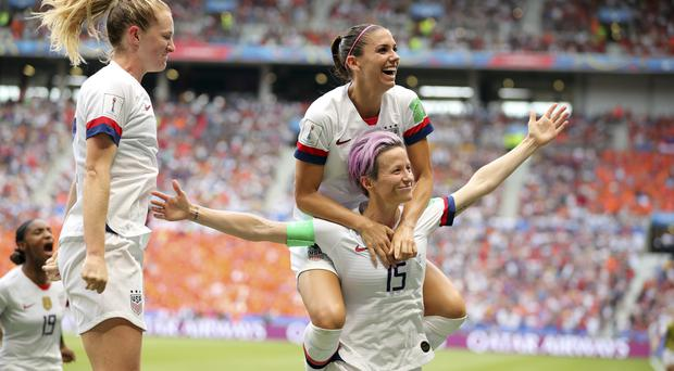United States' Megan Rapinoe (15) and team-mates celebrate after Rapinoe scored the opening goal from the penalty spot (AP)