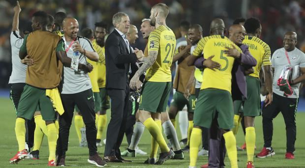 Stuart Baxter, centre, saw his South Africa side produced an unexpected 1-0 win over hosts Egypt (Hassan Ammar/AP Photo)