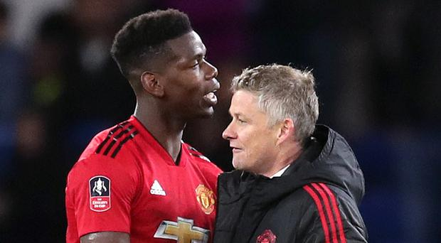 Solskjaer insists United are not forced to sell wantaway stars such as Paul Pogba (left) (Adam Davy/PA)