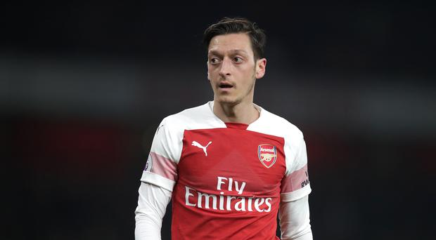 Mesut Ozil has been linked with a move away from Arsenal this summer (Adam Davy/PA)