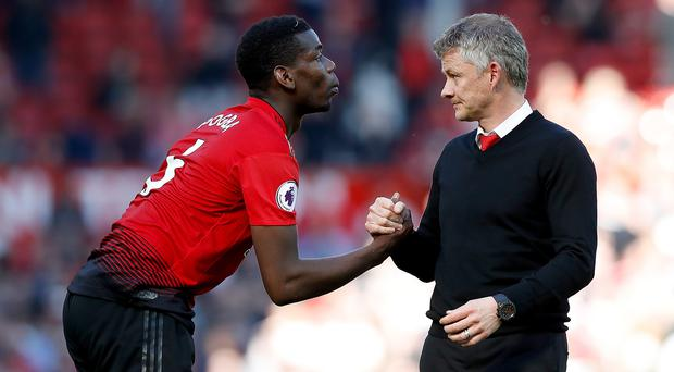 Ole Gunnar Solskjaer (right) is not ruling out a captaincy role for Paul Pogba (Martin Rickett/PA)