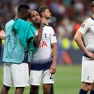 Tottenham's Victor Wanyama (centre left) consoles Lucas Moura after the Champions League final defeat against Liverpool in Madrid.
