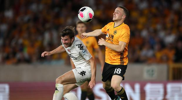 Wolverhampton Wanderers' Diogo Jota (right) and Crusaders' Philip Lowry battle for the ball during the Europa League Qualifying match at Molineux, Wolverhampton.