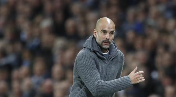 Pep Guardiola does not expect to need to drive his players as hard this season (Martin Rickett/PA)