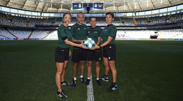 Manuela Nicolosi, fourth official Cuneyt Cakir, Stephanie Frappart and Michelle O'Neill pose with the official match ball (handout)