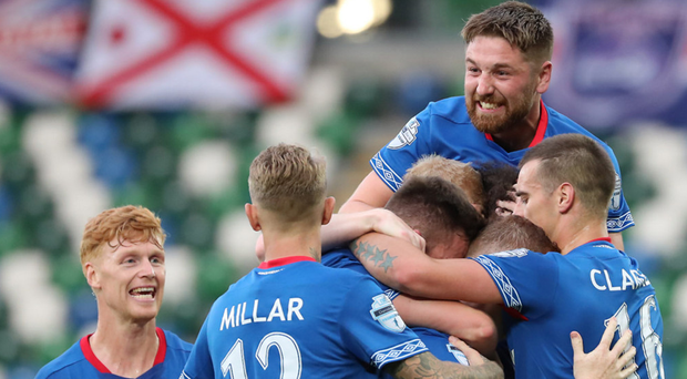Linfield players, including Mark Stafford (top), rush to congratulate scorer Shayne Lavery during the third qualifying round win over FK Sutjeska