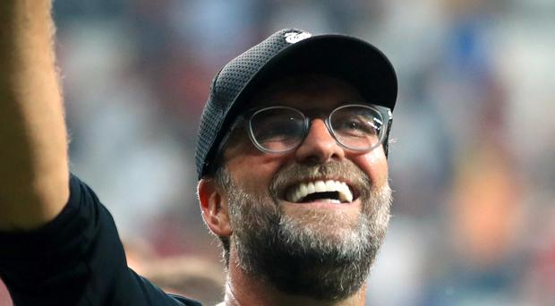 Liverpool manager Jurgen Klopp celebrates after his side win the UEFA Super Cup Final at Besiktas Park, Istanbul.