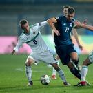 Bosnia and Herzegovina's Edin Dzeko (centre) battles for the ball with Northern Ireland's Steven Davis (left) and Corry Evans (Tim Goode/PA)