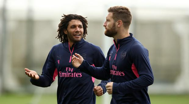 Arsenal's Mohamed Elneny (left) and Shkodran Mustafi have been told they can leave (John Walton/PA)