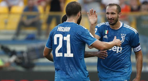 Giorgio Chiellini's first-half goal proved enough to give Juventus victory in their first Serie A match of the new season (Antonio Calanni/AP)