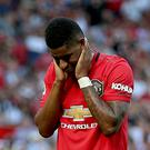 Manchester United's Marcus Rashford appears dejected after missing from the penalty spot (Nigel French/PA)