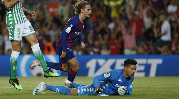 Barcelona's Antoine Griezmann, center, scores his side's first goal during the Spanish La Liga soccer match between FC Barcelona and Betis at the Camp Nou stadium in Barcelona, Spain, Sunday, Aug. 25, 2019. (Joan Monfort/AP)