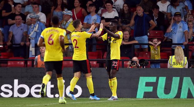 Ismaila Sarr, right, marked his first Watford start with a goal in a 3-0 win over Coventry in the Carabao Cup (Steven Paston/PA)