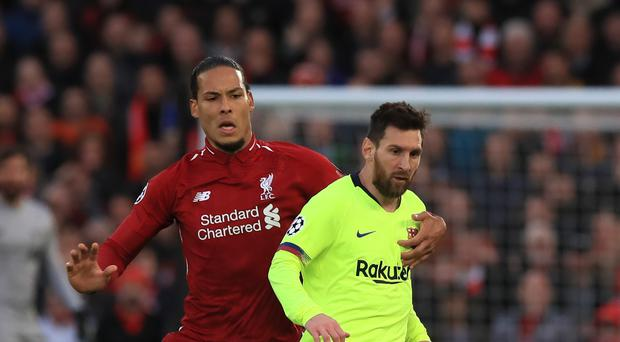 Liverpool defender Virgil Van Dijk is competing with Lionel Messi and Cristiano Ronaldo for FIFA's Best Men's Player Award (Peter Byrne/PA)
