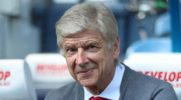 Could Arsene Wenger be set to take up a fresh challenge in international football? (Mike Egerton/PA)