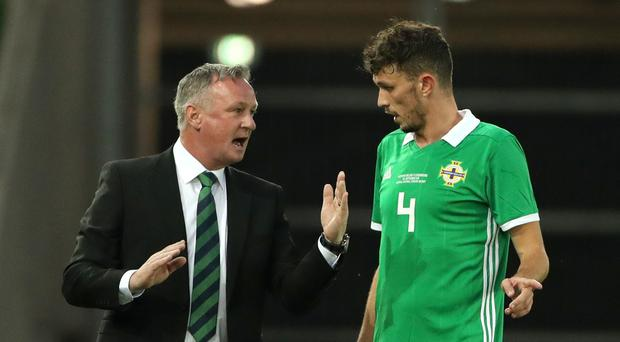 Michael O'Neill gives instructions to Tom Flanagan during Thursday's win over Luxembourg (Liam McBurney/PA)