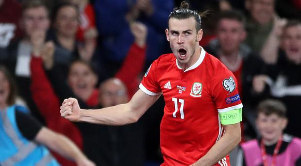 Gareth Bale celebrates scoring Wales' winner in their 2-1 victory over Azerbaijan (Nick Potts/PA)
