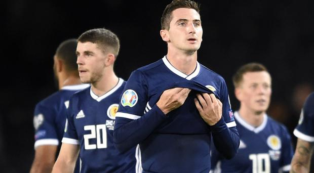 Scotland's Kenny McLean, centre, appears dejected after the final whistle (Ian Rutherford/PA)