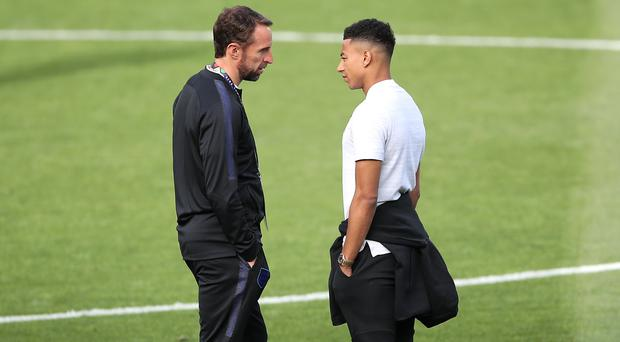 Jesse Lingard, right, has pulled out of Gareth Southgate's England squad (Tim Goode/PA)