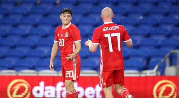Daniel James (left) celebrates scoring for Wales against Belarus in Cardiff (Nick Potts/PA)
