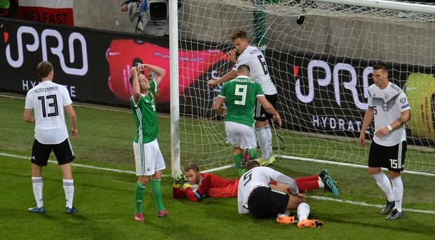 So close: George Saville holds his head in his hands as Northern Ireland miss another great chance against Germany