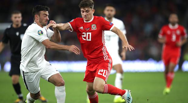 Daniel James, right, was praised by his manager Ryan Giggs after his match-winning performance against Belarus (Nick Potts/PA)
