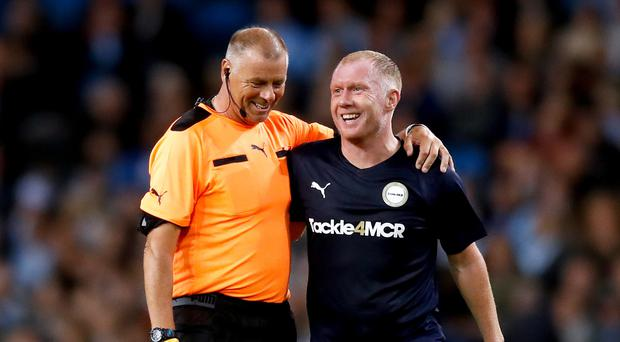Referee Mark Halsey (left) with Premier League All Stars XI's Paul Scholes during the Vincent Kompany Testimonial at the Etihad Stadium, Manchester (Martin Rickett/PA)