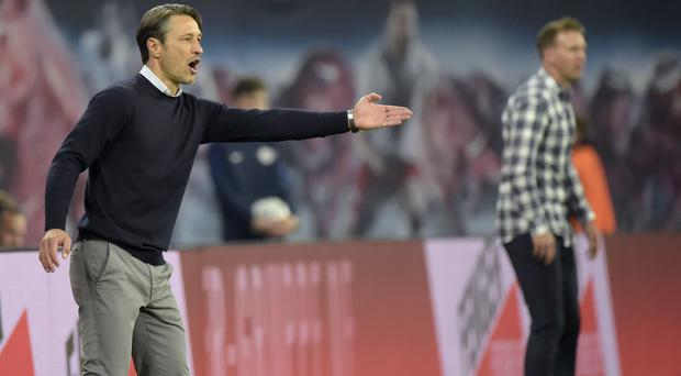 Niko Kovac, left, saw his Bayern Munich side held by RB Leipzig (Jens Meyer/PA).