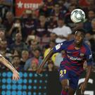 Ansu Fati, right, has made a huge impression for Barcelona (Joan Monfort/AP)