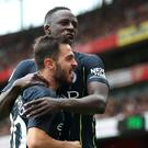 Bernardo Silva (front) should face action for his tweet about team-mate Benjamin Mendy, says Kick It Out (PA)