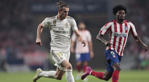 Gareth Bale, left, and Thomas Partey battle for the ball during the goalless draw (Bernat Armangue/AP)