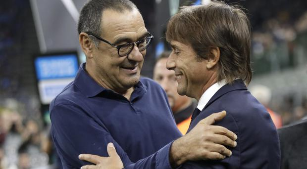 Maurizio Sarri's (left) Juventus defeated Antonio Conte's Inter Milan on Sunday night (Luca Bruno/AP)
