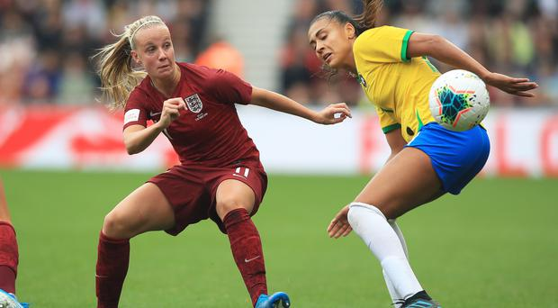 Beth Mead, left, was gifted a goal for England in Portugal (Owen Humphreys/PA)