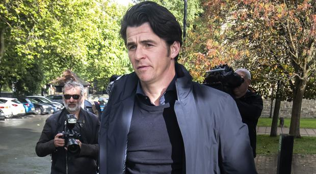 Joey Barton leaves Barnsley Magistrates Court, where he faced charges over allegedly attacking a rival manager.