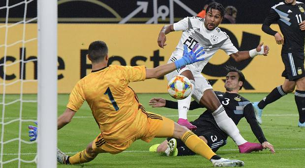 Serge Gnabry, centre, scores Germany's first goal (Martin Meissner/AP)