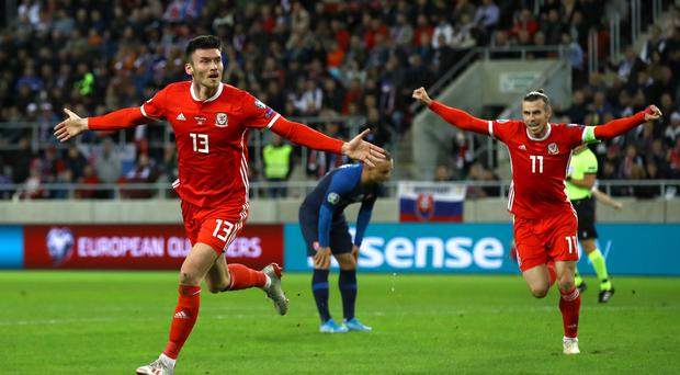 Kieffer Moore (left) celebrates scoring Wales' goal in their 1-1 Euro 2020 quaifying draw against Slovakia in Trnava (Tim Goode/PA)