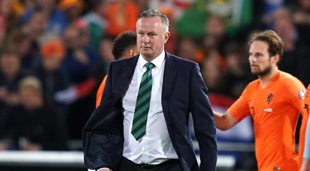 Michael O'Neill was 'devastated' by the late collapse in Rotterdam (John Walton/PA)