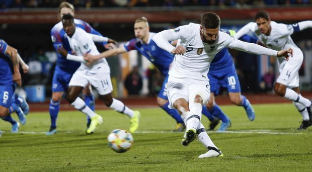 Oli­vier Giroud struck the only goal from the penalty spot (AP Photo/Brynjar Gunnarsson)