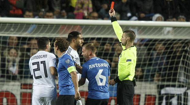 Germany defender Emre Can, centre, was sent off early on in Tallinn. (Raul Mee/AP)