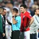 Match referee Ivan Bebek speaks to England manager Gareth Southgate and defender Harry Maguire regarding racist chanting from fans during the UEFA Euro 2020 qualifying match in Bulgaria (Nick Potts/PA)